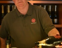 John pouring sparkling shiraz at Domaine Chandon
