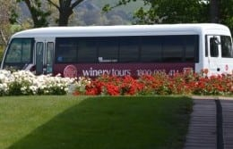 Side view of winery day tour bus