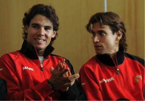 Rafael Nadal and David Ferrer sitting at press conference clapping